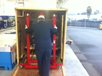 Honda tech unloading the equipment required to replace the Fit EV Battery